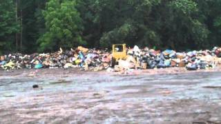 Cat 955l track loader pushing trash from hurricane Irene