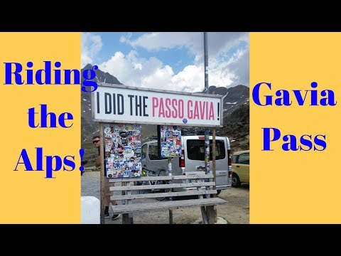 Motorcycle riding Gavia Pass in the Alps in Italy