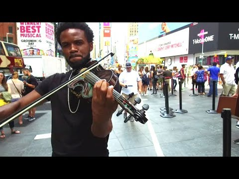 Shinsuke Nakamura's theme performed by Lee England Jr. in the middle of Times Square