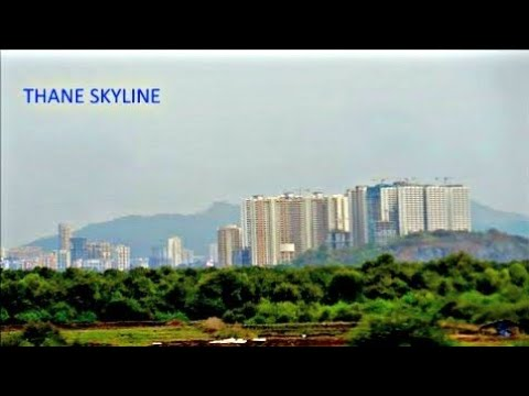 Indian Mega cities   Thane skyline from moving train   Indian railways