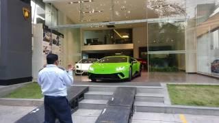 Lamborghini Huracan Performante driving out of showroom!
