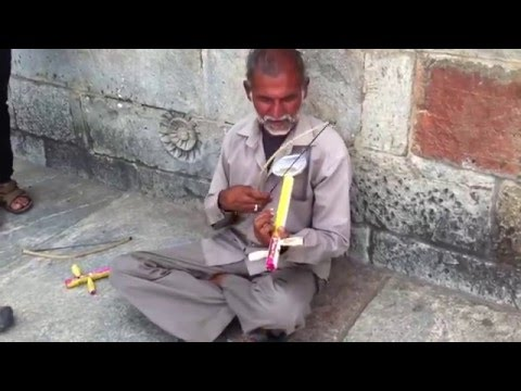 Street Performer Playing The Airtel Tune Outside A Temple  AR REHMAN TUNE