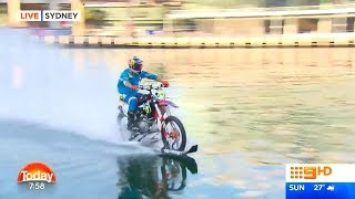 Robbie Maddison rides his Motorbike over waters at Darling Harbour, Sydney