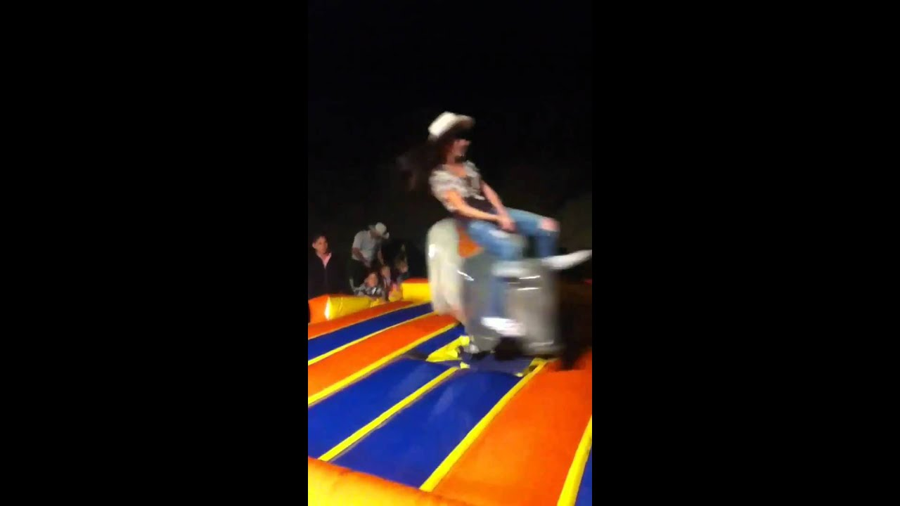 Fat girl on mechanical bull