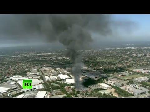 Massive fire sends smoke plume over Sydney