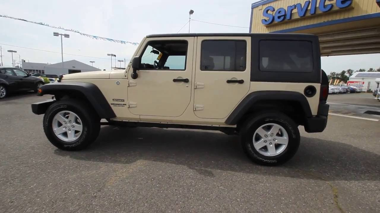 2012 Jeep Wrangler Unlimited Sport | CL109463 | Sahara Tan Clearcoat