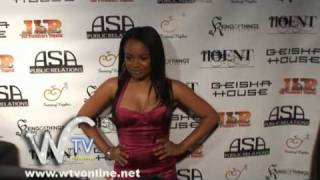 Kyla Pratt blowing kisses on red carpet