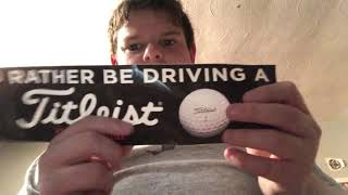 Showing you guys my golf ball and golf bumper sticker from titleist factory