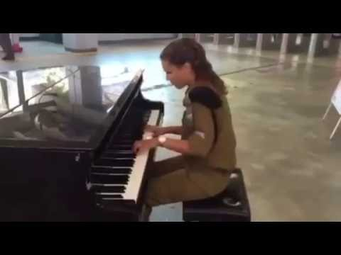 Female Israeli soldier playing piano at train station (Israel IDF Israeli army soldiers)