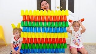 Pretend play kids Alice with colored cups