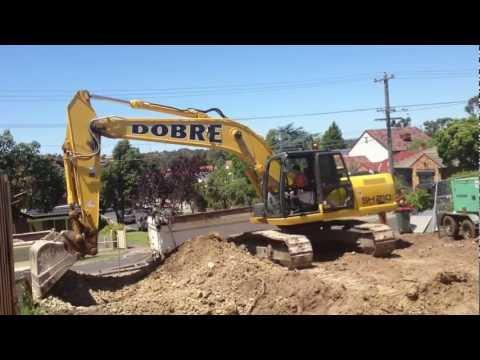 excavating a site cut sumitomo sh210