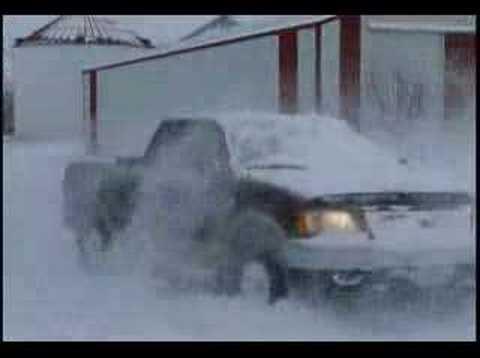 Truck Hitting Big Snow Drift