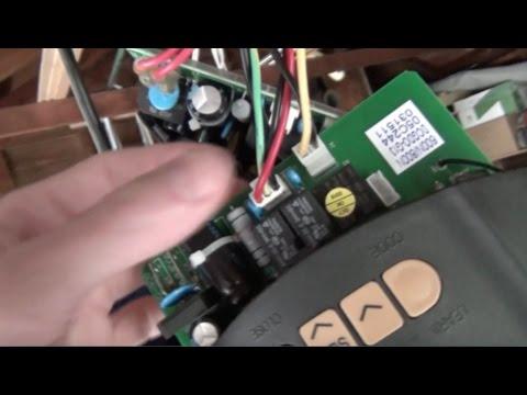 Repairing A Garage Door Opener And Programing The Remote