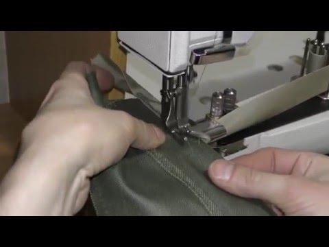 Промышленная швейная машина для окантовки края изделия.