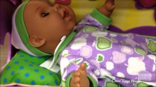 Baby Doll With Purple Cradle Plays Lullabies