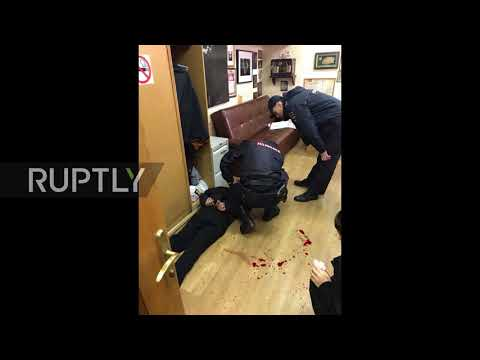 Russia: Intruder stabs Echo of Moscow radio show host in the throat *STILLS*