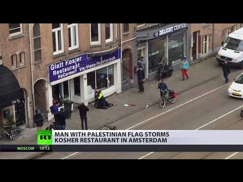 Man with Palestinian flag storms Israeli restaurant in Amsterdam