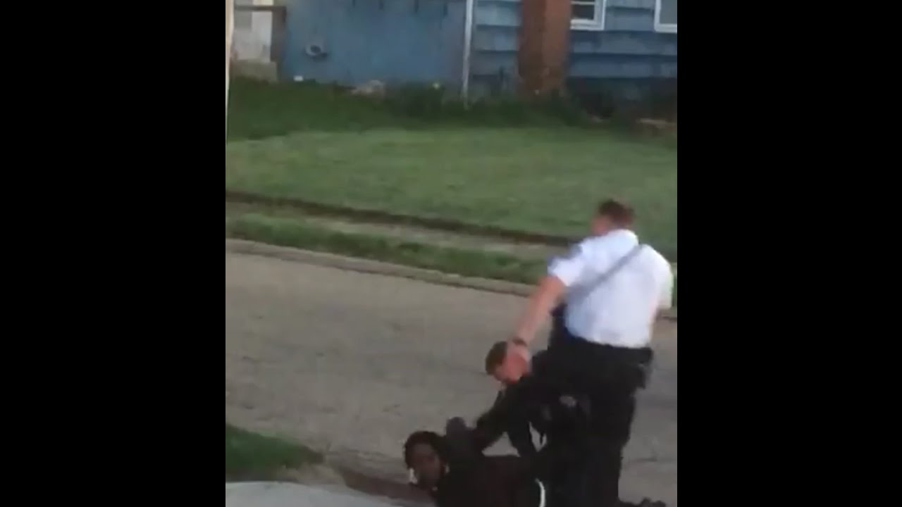 Columbus police officer curb stomps handcuffed man (full length)