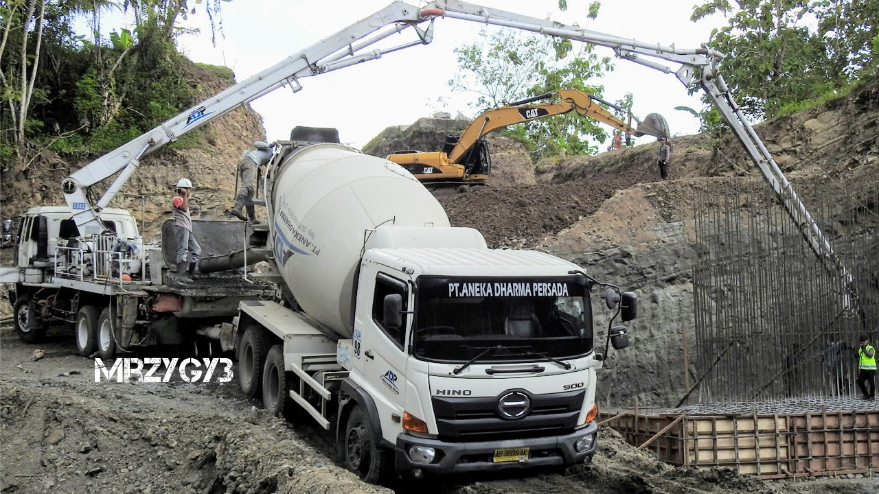 cool ready mix concrete pump truck working on steep site. Black Bedroom Furniture Sets. Home Design Ideas