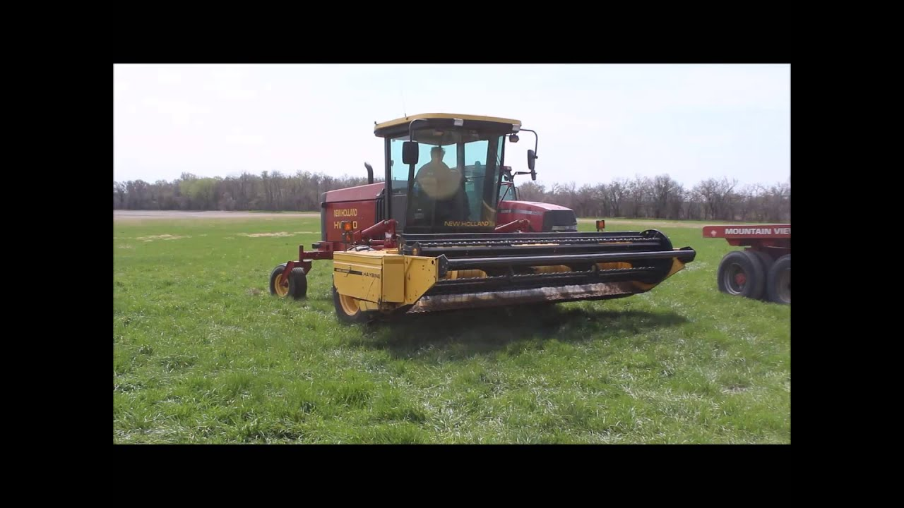 2001 New Holland HW340 swather for sale | sold at auction May 14, 2014