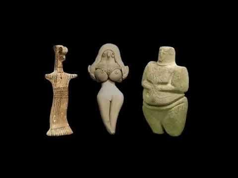 Dancing prehistoric Statues