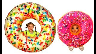Dominika and doll play with giant Donuts