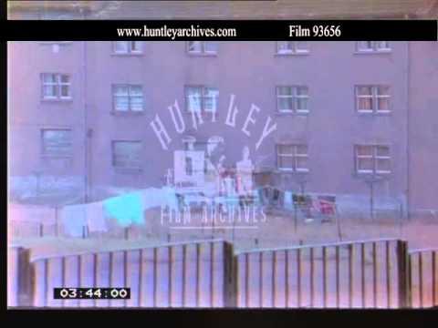 Easterhouse, Glasgow filmed from a car.  Archive film 93656