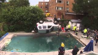 women drives jeep into pool ... pulled out by crane