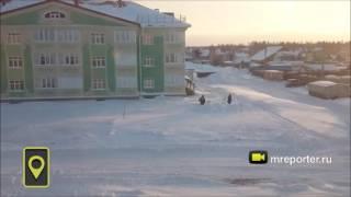 Снегопад в Нижневартовске: машины замело на парковках