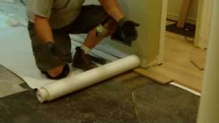 Leveling Subfloor Before Wood Floor Installation Using Asphalt Shingles And Roofing Felt