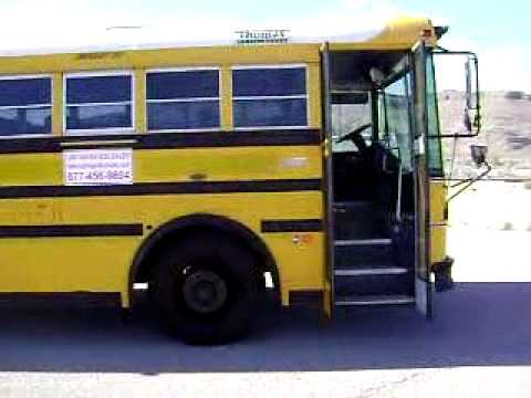 An awsome used school bus for sale with high capacity seating and Air  Conditioning!