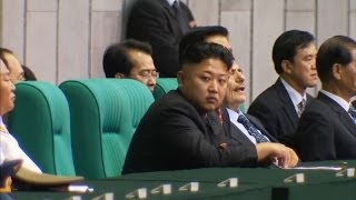 Repeat youtube video Kim Jong-Un Official Laughs As He Says Leader's Uncle Was Shot, Not Torn Apart By Dogs