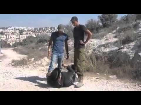 Nazi Zionist illegal settlers torture a Jewish rabbi for his anti-Zionism beliefs.