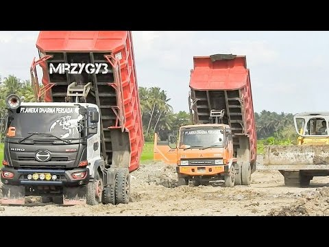 Dump Truck Delivering And Unloading Dirt At Road Construction Site