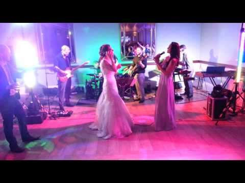 Bridesmaid sings at best friends wedding the song they wrote as children.