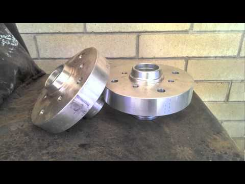AE86 Corolla Sprinter aftermarket alloy hubs with extra track.