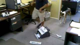 Glen Glass doing a butt slam on a fax machine in the office