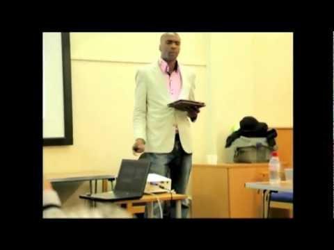 Onyi Anyado delivering a keynote presentation on vision at 'Raise Your Game' Seminar. Part 2.