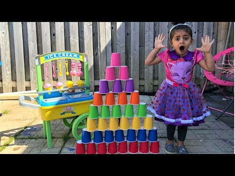 Kids pretend play Builds COLORFUL Cup Wall with Ice Cream Toys