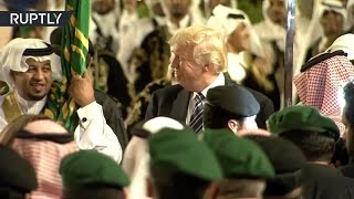Saudi Night Fever  Trump steps out with traditional Arabian sword dance