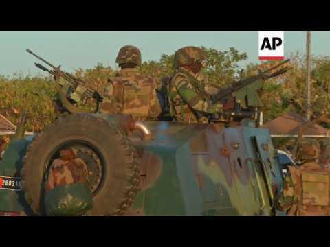 ECOWAS troops in Banjul, people celebrating
