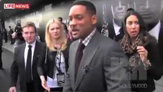 Will Smith slaps male reporter for kissing him