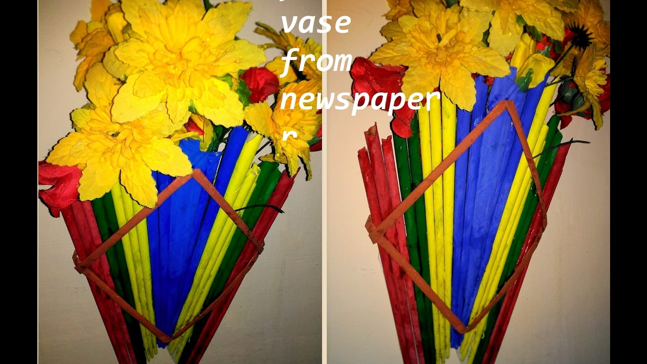 Flower vase from newspaper wall hanging best out of for Wall hanging best out of waste