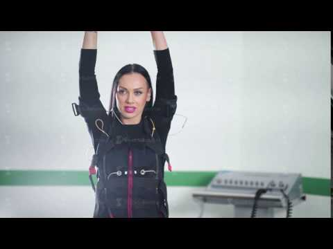 EMS fitness girl in electrical muscular stimulation suit doing exercise