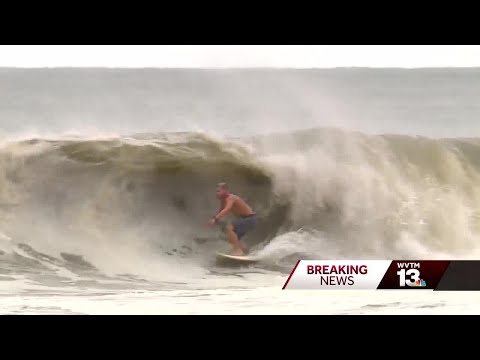Surfers in Orange Beach, Alabama