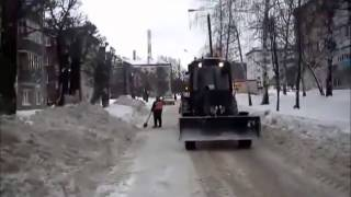Russian town, tired of illegal parking blocking snow removal, places cars on top of the snow banks.