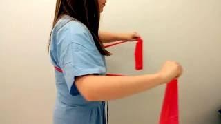 Retracción escapular con resistencia elástica Fase 2 vista lateral del ejercicio