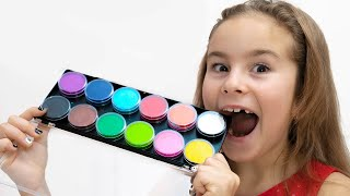 Мелисса и Артур играют с шоколадными сладостями