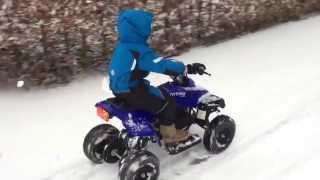 Fun with the kids on their electric mini quad snow