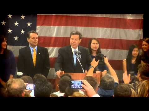 Republican Sam Brownback celebrates re-election as Kansas governor